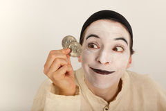 The clown with a purse and coins in his hand Stock Photos