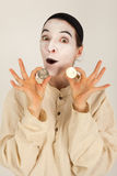 The clown with a purse and coins in his hand Royalty Free Stock Images