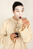 The clown with a purse and coins in his hand Stock Images