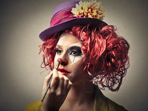 Clown putting on some make-up Stock Image