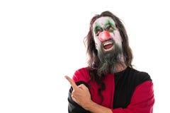 Clown rampant indiquant avec son doigt le copyspace, d'isolement dessus photo stock