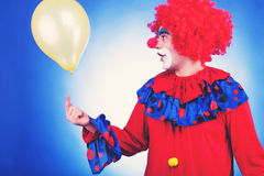 Clown in red costume with balloon toned image Royalty Free Stock Photography