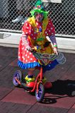 Clown riding Bicycle. On boardwalk during parade.Taken August 16, 2014 Royalty Free Stock Images