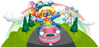 A clown riding in a pink car with balloons Stock Photos
