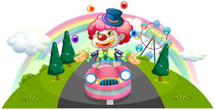 A clown riding in a pink car while juggling Royalty Free Stock Photo
