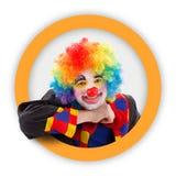 Clown in rond oranje frame Stock Afbeelding