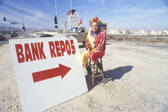 Clown salesperson with Bank Repo sign Stock Image