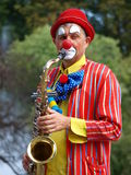 Clown saxophonist, Lublin, Poland. The march-past of the royal suite and jugglers during the annual Jagiellonian Fair (12th-14st August 2011), Lublin, Poland Stock Photo