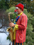 Clown saxophonist, Lublin, Poland. The march-past of the royal suite and jugglers during the annual Jagiellonian Fair (12th-14st August 2011), Lublin, Poland Stock Image