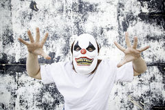 Clown scaring. Crazy clown mask halloween costume and fear royalty free stock photography