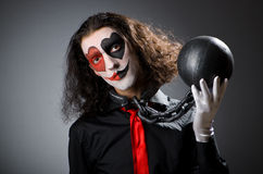 Clown with shackles Royalty Free Stock Image