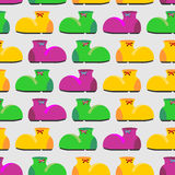 Clown shoes funny seamless pattern. Multicolored shoes backgroun Stock Image
