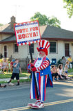 Clown with Sign at Parade Stock Photo