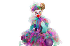 Clown sitting cross-legged Stock Images