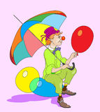 Cartoon clown. Clown sitting and holding balloons Royalty Free Stock Photo