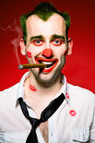 Clown smoking cigaro Stock Photo
