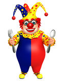 Clown with Spoons Stock Photo