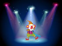 A clown at the stage with spotlights Stock Image