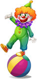 A clown standing above the ball Royalty Free Stock Photo