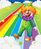 A clown standing in the colorful road Stock Images