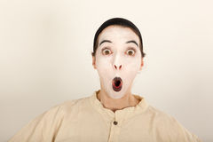 The clown is standing in front of a camera and making a face Royalty Free Stock Photography