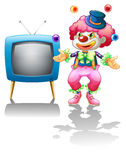 A clown standing near the T.V. vector illustration