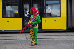 Clown standing on the street, Berlin, October 2015 Stock Photo