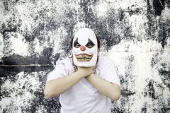 Clown strangling. Crazy clown mask halloween costume and fear royalty free stock photo