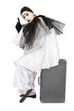 Clown sur la valise avec l'isolat de geste d'exclamation Images stock