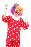 Clown taking selfie with his thumb up Royalty Free Stock Photography