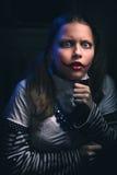 Clown teen girl afraid. Portrait of an afraid clown teen girl stock images