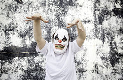 Clown Terror Scare. Crazy clown mask halloween costume and fear royalty free stock photos