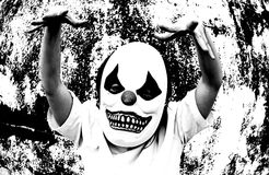 Clown Terror Scare. Crazy clown mask halloween costume and fear royalty free stock photography