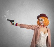 Clown thief shoots Royalty Free Stock Image