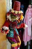 Clown toy. Sad clown in bright clothes, santorini shop Stock Photos