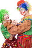 Clown tries to strangle a female clown Royalty Free Stock Image