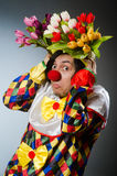 Clown with tulip flowers in funny concept Stock Photos