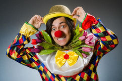 Clown with tulip flowers in funny concept Royalty Free Stock Photos