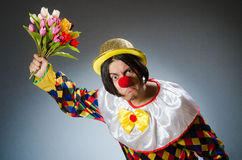 Clown with tulip flowers in funny concept Stock Photography