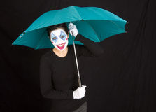 Woman Playing Clown with Teal Umbrella Black Royalty Free Stock Photo