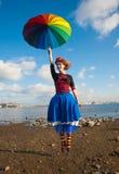 Clown with umbrella Stock Photos