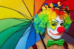 Clown with umbrella Royalty Free Stock Photo