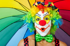Clown with umbrella. Isolated on white stock photo