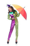 Clown with umbrella Stock Images