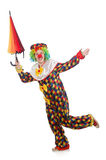 Clown with umbrella isolated on white Stock Photo