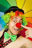 Clown with umbrella  Royalty Free Stock Image