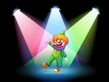 A clown under the spotlights Royalty Free Stock Image