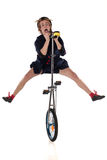Clown with a unicycle Stock Photo