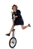 Clown with a unicycle Stock Images