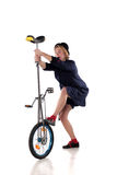 Clown with a unicycle. Clown entertainer trying to mount a unicycle Royalty Free Stock Photography